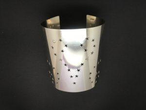 Silver cuff with pierced stars